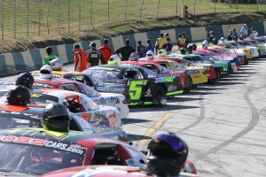 30 ACT Late Model Stock Cars lineup for the season-opening Merchants Bank 150 at Barre's Thunder Road.  The Mekkelsen RV Memorial Day Classic on Sunday, May 26 will serve as the first Vermont State Championship Series race, and the kickoff to the King of the Road title chase.  (Photo Credit: Leif Tillotson)